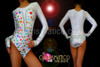 Brightly bejeweled corset illusion leotard in white with silver sequin trim