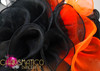 CHARISMATICO asymmetrical organza ruffled headdress in orange and black with feather accents