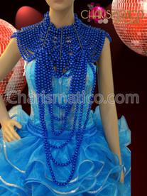Light blue corset, organza ruffled skirt, showgirl's necklace, and headdress