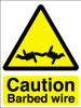 Caution barbed wire sign