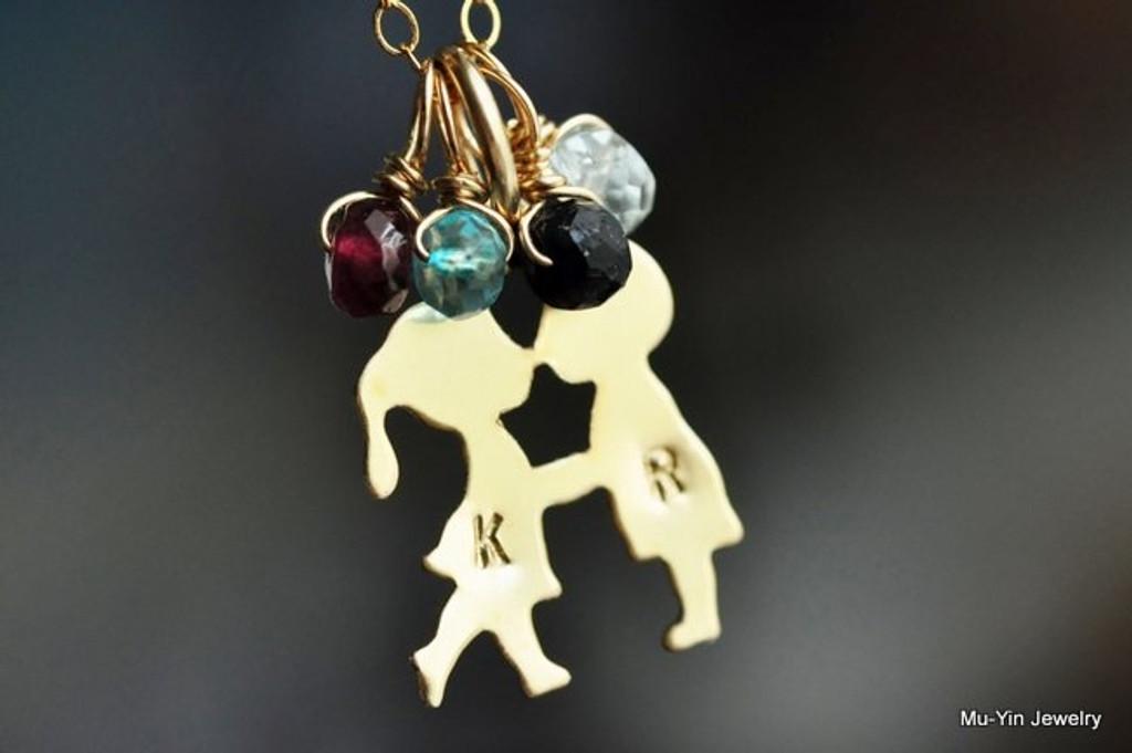 boy girl kissing birthstone necklace