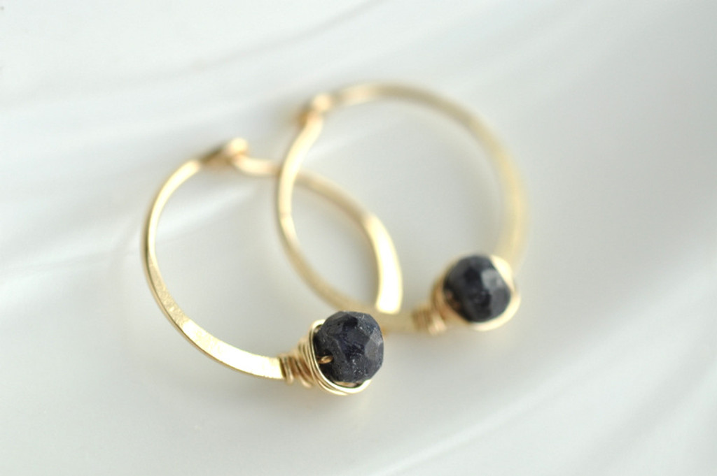 """5/8"""" gold hoops with sapphire"""