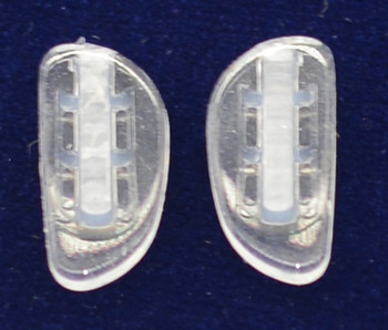 """Premium grade soft silicone """"Bayonet"""" mount """"Zeiss"""" nose pads size about 17mm long by 8mm wide and 2.8mm think Shape is """"D"""".  The Bayonet mount is a wire, prong or small diameter shaped wire that is inserted into the end of the nose pad. This nose pads can be used to replace existing hard or soft nose pads with the same mount.  This is the very best nose pad. Packaged and sold in three pair bags"""