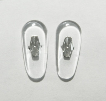 Crimp-On nose pad 19mm length in Tear-drop shape made from PVC with silver color metal insert.  The mount has two flat bars that can be bent to secure pad to nose pad arm.  This is pad was extensively used on older B & L frames.   Packaged in 10 pair bags