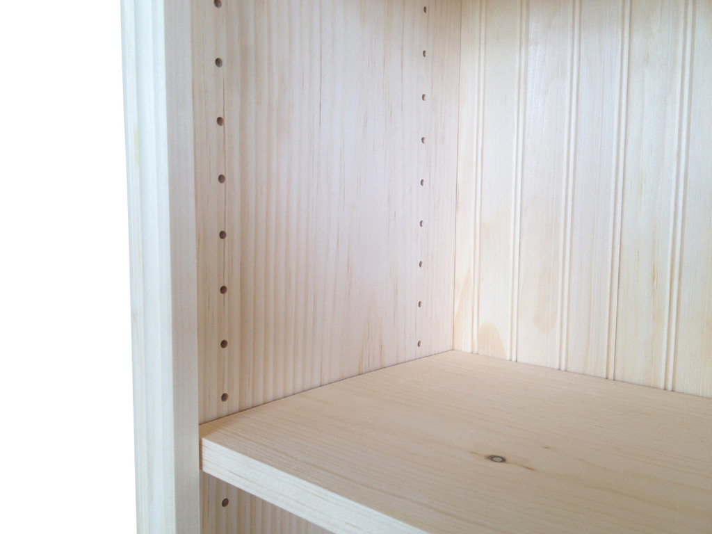 "Adjustable shelves on 1.25"" centers"