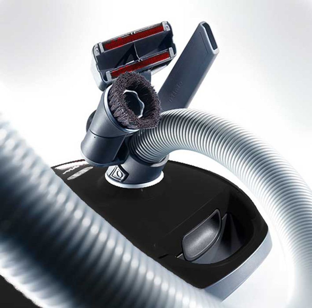 Attachments can clip onto the hose for portability.
