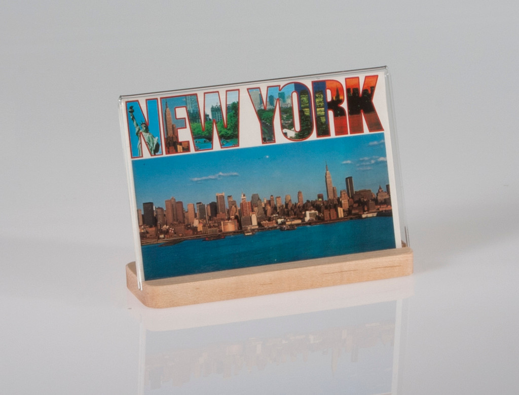 "Attractive photo sized clear acrylic frame features an elegant maple base. 6"" x 4"" Horizontal"