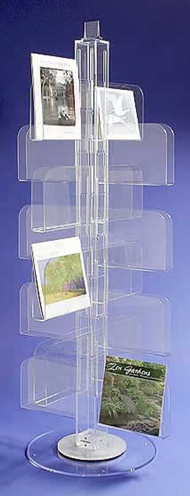 Clear acrylic floor spinner for calendars and larger items for retail display.