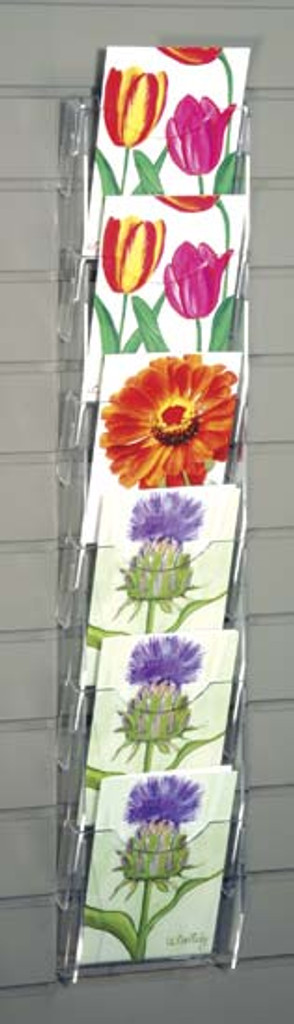 Clear acrylic slatwall mounted postcard/ greeting card rack with six pockets.