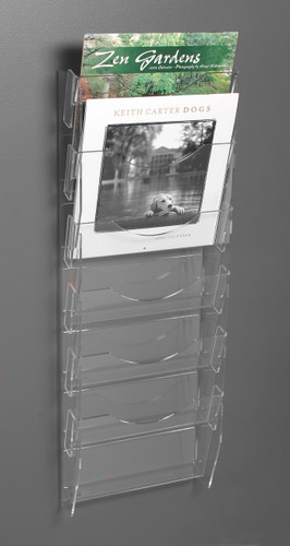 Clear acrylic wall mounted calendar rack with six pockets.