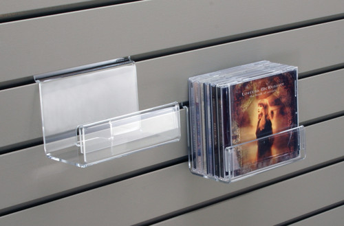 This clear acrylic small shelf is the perfect size for CDs, DVDs, or books and has a built in sign holder. The shelf is ready to hang on existing slatwall.