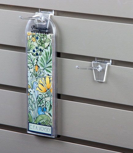 Clear acrylic hooks for slatwall; these almost invisible hooks are a great way to display and organize.