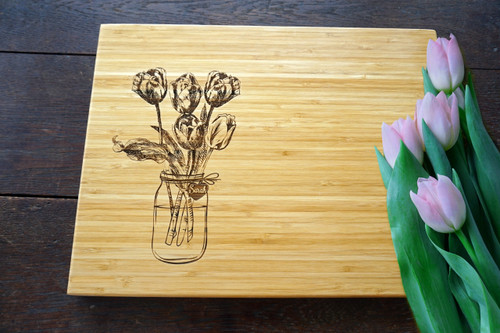 Tulip in a mason jar cutting board