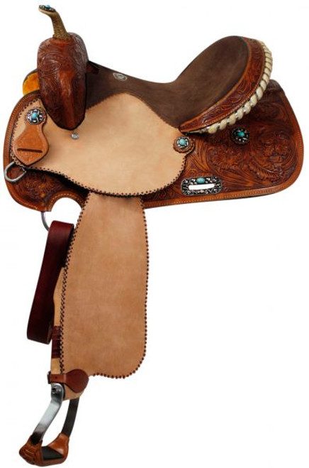 Double T barrel saddle with silver laced tan rawhide cantle, dot border on rough out fenders and jockeys. Saddle features fully floral tooled pommel, skirts, and cantle.