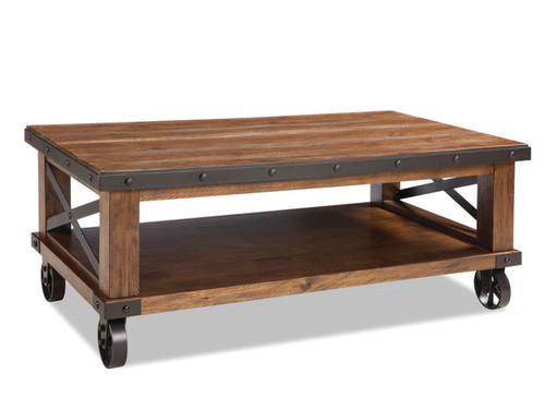 Taos C•Constructed from solid Pine and Pine veneers with select hardwoods and metal accents •Coffee and side tables have metal stretcher for increased durability and aesthetic design •Coffee table available either with or without caster iron wheels offee Table with Caster