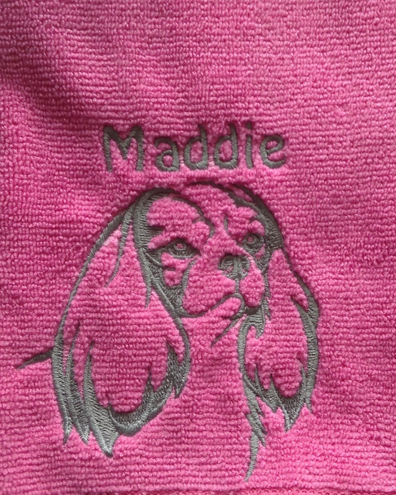 Cavalier (Fancy) on hot pink towel with light gray thread