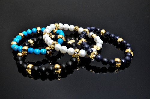 Gold Skulls of 18K & Diamond Eyes on Beaded Bracelets