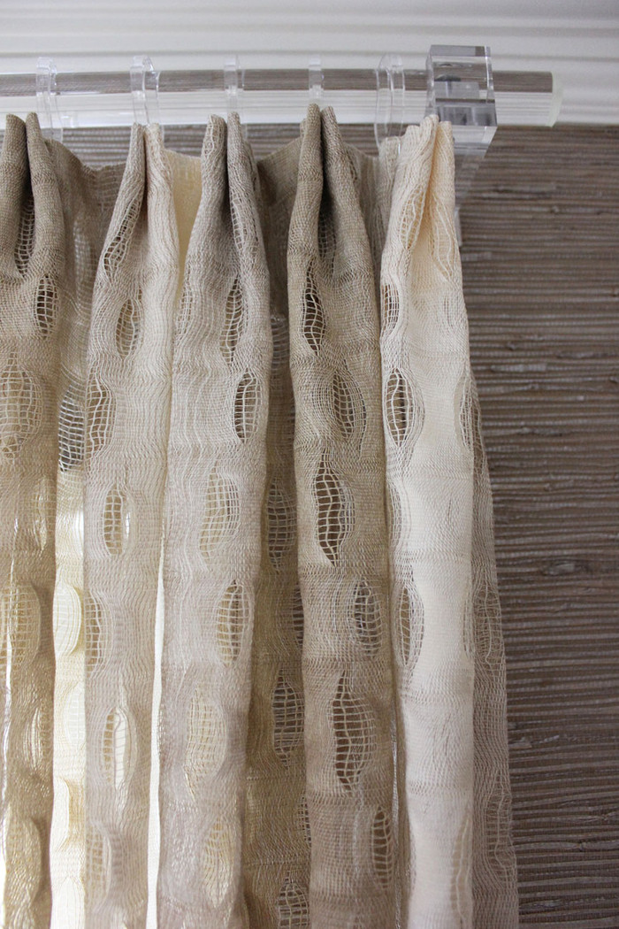 Custom Drapes by Lynn Chalk in Isis Ombre in Creme.  Clear Acrylic drapery hardware is by Design Elements Group (Metropolitan Collection)