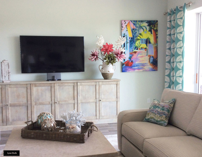"Custom Grommet Drapes by Lynn Chalk in Duralee 42190-23 Peacock. Pillow on sofa is in Robert Allen Distant Dawn in Viridian. (Picture sent in by client.. ""They are fabulous,  really brighten our living room. Thank you so much"")"