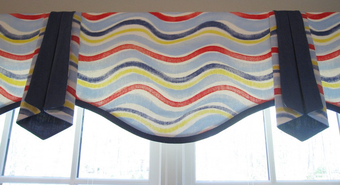 This is a Valance I designed.  It is a simple style with a serpentine bottom with separate side pieces that are lined with a contrasting color.