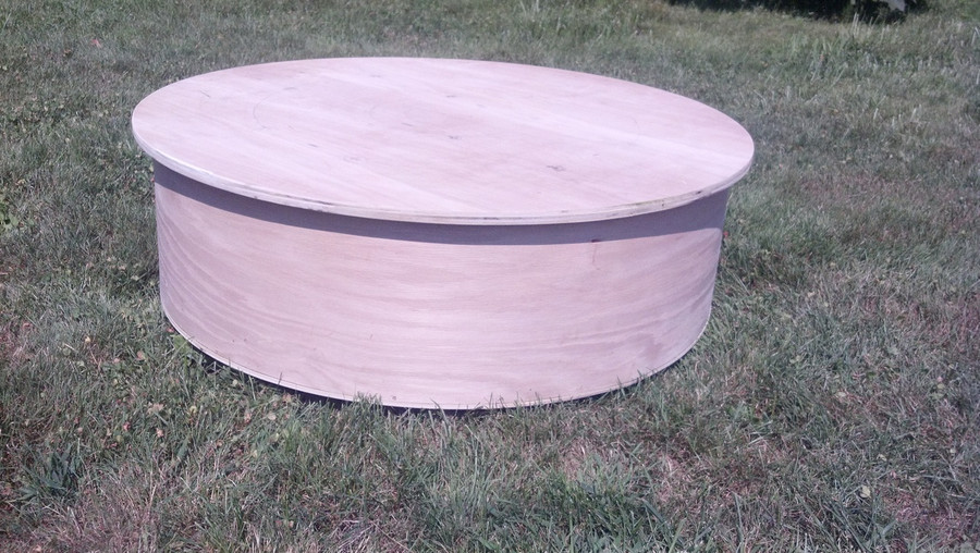 Base is hand constructed in Birch and is very solid and sturdy.  Total finished weight of this ottoman is about 40 lbs.