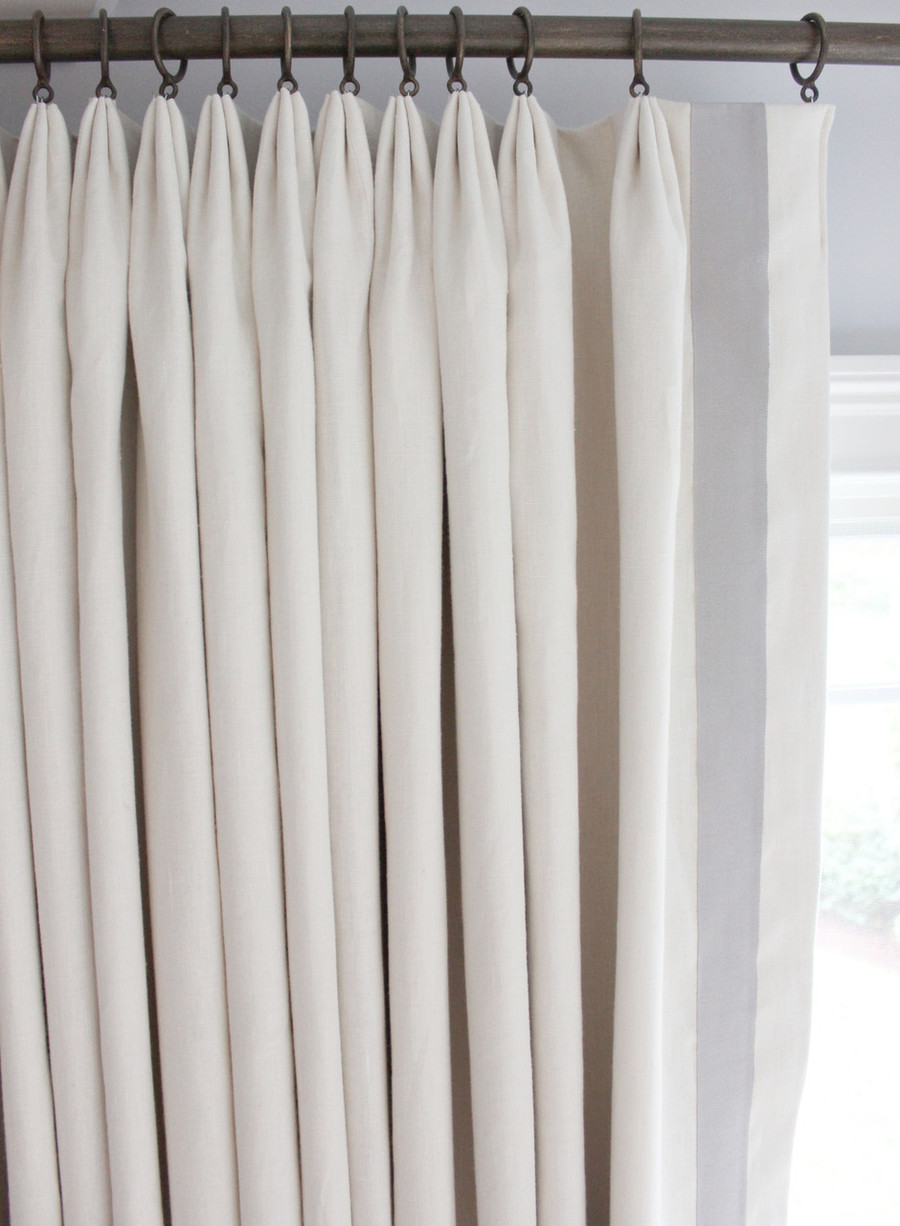 "Kravet Dublin Linen in Creme with 2"" Wide Samuel & Sons Grosgrain Ribbon Trim in Mercury set in 1 1/2"" from edge.  Drapes are Triple Wide with Euro Pleat."