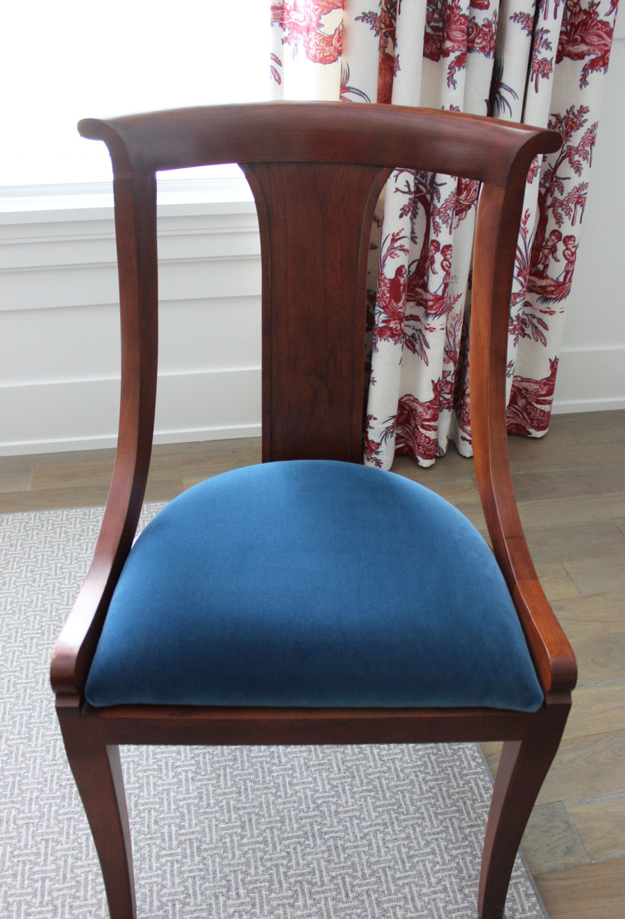 Dining Room Chairs covered in Ralph Lauren Moleskin Velvet in Prussian Blue.  Drapes are Alessandra Branca Continenti in Rouge/Prussian.  Prussian Blue Velvet is a perfect match to the Prussian Blue outline in the drapes.