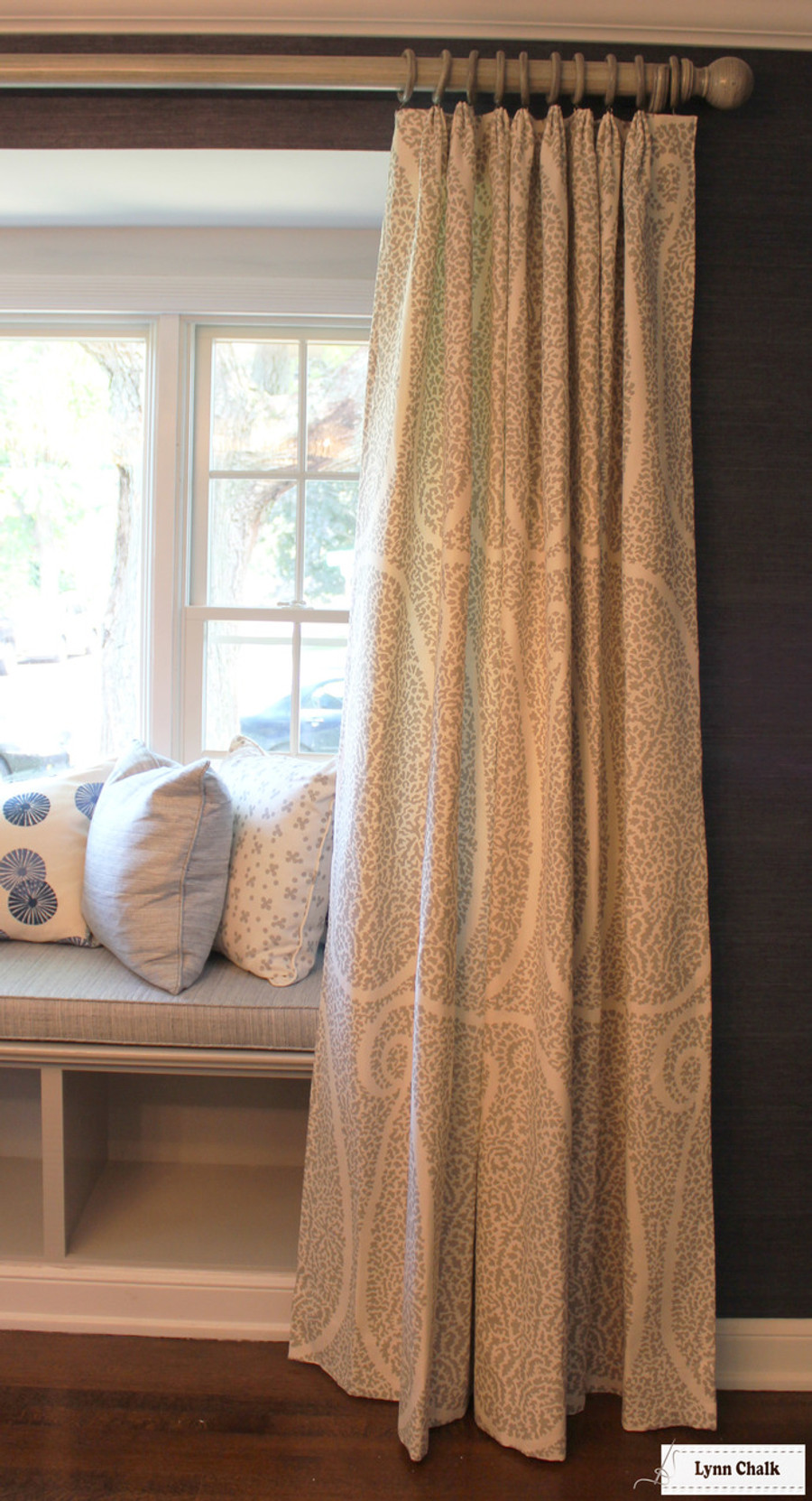 Schumacher Ambala Paisley Fog Drapes with Western Wood Supply Drapery Hardware Painted in Old Ivory.   Cushion in Schumacher Travertine Linen Weave in Denim.  Pillows in Groundworks Kasa and Christopher Farr Pollen. (Erika Mercurio Design)