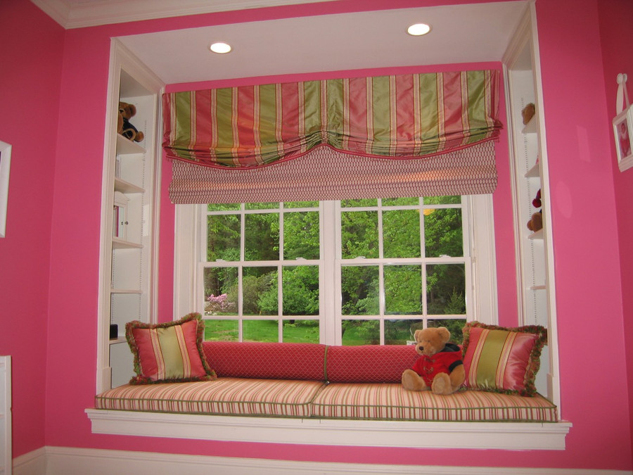My custom valance, roman shades, window seat cushions, bolsters and pillows appeared in At Home Magazine.