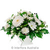A Beautiful Sympathy White Ceramic supplied by Ipswich Florist.