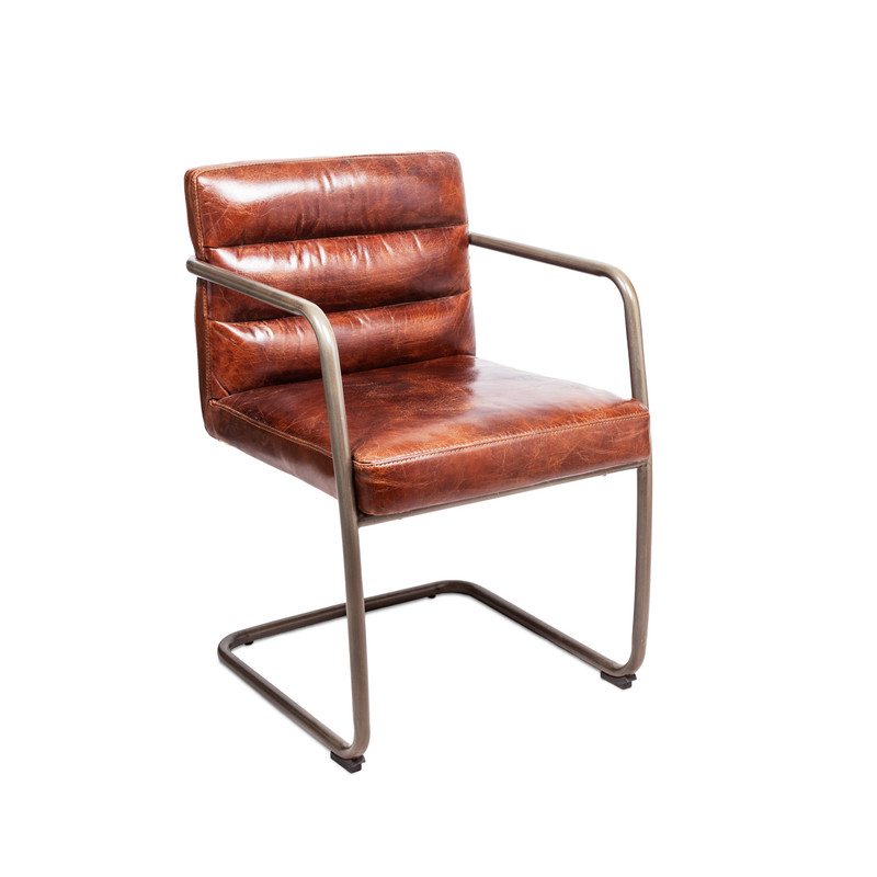 Our aged leather B52 chair with cantilever steel base is a superbly comfortable desk chair, office chair, or occasional armchair. With its channel back cushion stitching and supportive frame, the B52 chair will make sure you are comfortable and relaxed as you put together those big deals. Three quarter view.