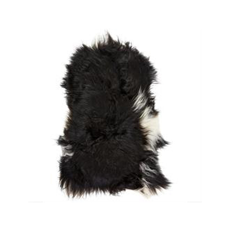 Icelandic Sheepskin Black with White Spot. Add warmth, texture and luxury to your space with this naturally silky soft long haired Icelandic Merino sheepskin throw rug in black with white spot. Front view.