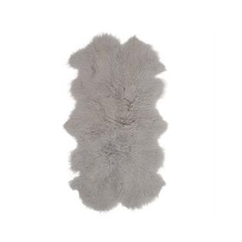 Mongolian Sheepskin Throw Light Grey. Add warmth, texture and luxury to your space with this naturally silky soft sheepskin throw rug in light grey. Front view.