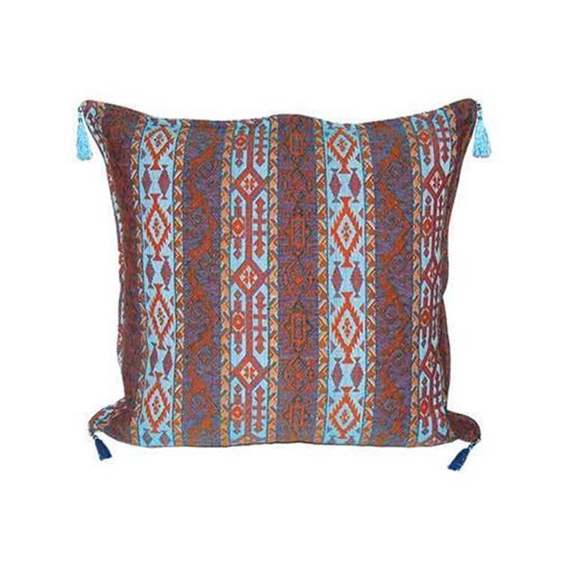 Our Turkish Cushion Yedi is created using the highest quality fabrics with traditional Turkish designs. Ottoman period fabrics were highly regarded by the court as the pinnacle of textile workmanship.  Featuring bright and contrasting colours, our Turkish Cushion Yedi will bring life and vibrancy to every setting. Front view.