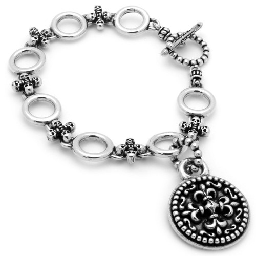 TWISTED BLADE SILVER CIRCLE & SKULLS BRACELET WITH FLEUR DE LIS PENDANT