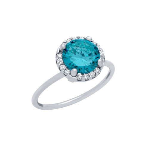 RHODIUM PLATED TOPAZ BLUE ROUND CZ RING WITH SURROUNDING CLEAR CZ STONES