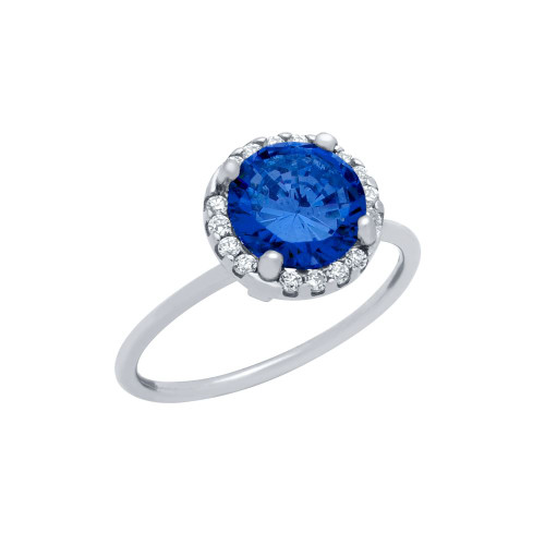 RHODIUM PLATED 7.5MM BLUE ROUND CZ RING WITH SURROUNDING CLEAR CZ STONES