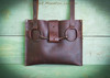 Dark Brown Bison Leather Horse Bit Tote Bag.