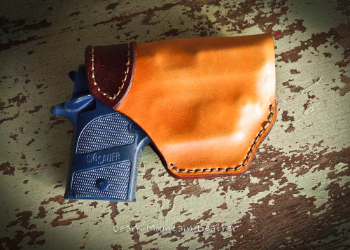 leather Holster for Small to Medium Size Guns in vegetable tanned leather and Bison leather