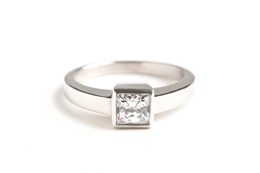 14kt white gold princess cut diamond solitaire engagement ring.  Contact us for exact pricing and diamond information. This ring can be made in any combination of stone size and metal type.  Starting at $1500.