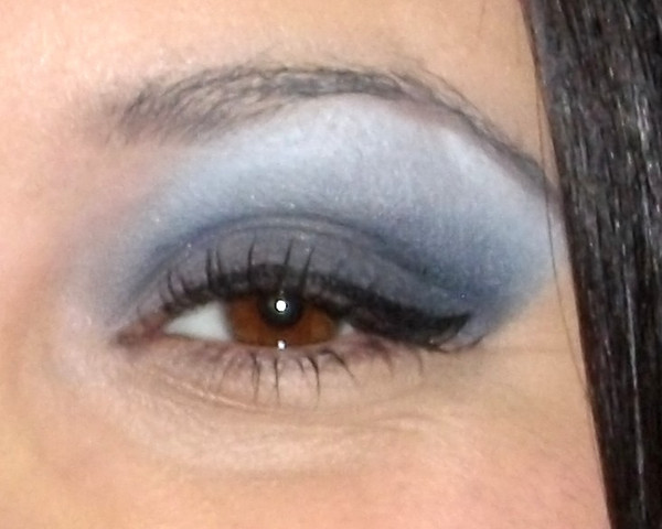Use lighter color just under the eyebrow, darker colors in the outer corner & crease line.