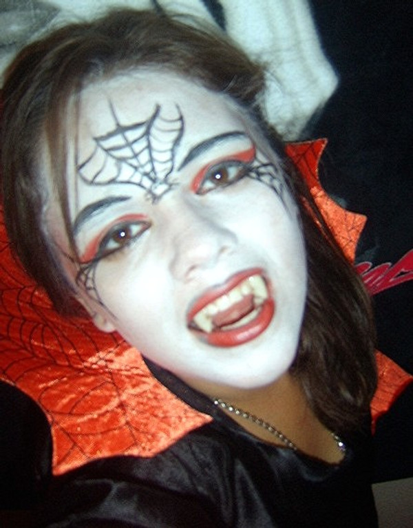 Vampire natural costume makeup design. Colors used: Red, black, white.