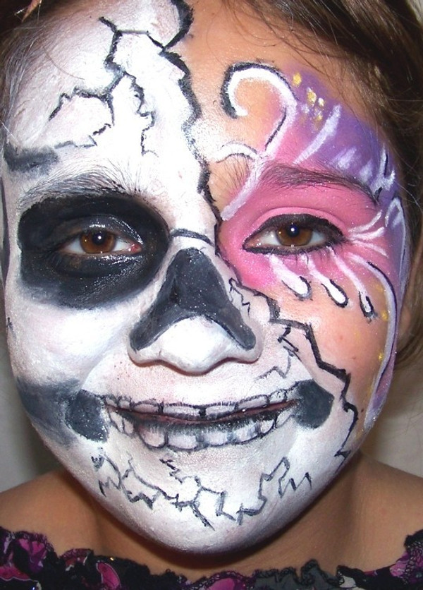 Skeleton Costume makeup design can be created with black, white, purple, and  hot pink. You can substitute the pink shown in the picture for any other color scheme you like.