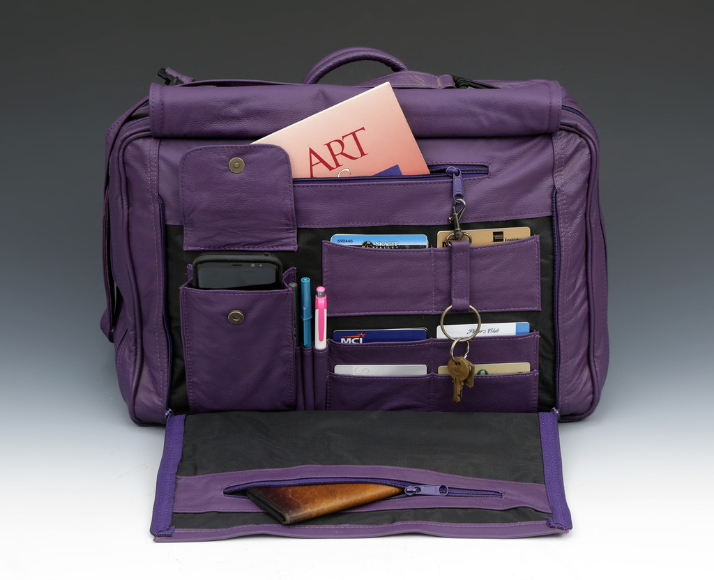 Many pockets under front flap for organization