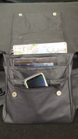 Two pockets and a zipper in front will hold folders, planners, tablets, or any other necessities one would need.