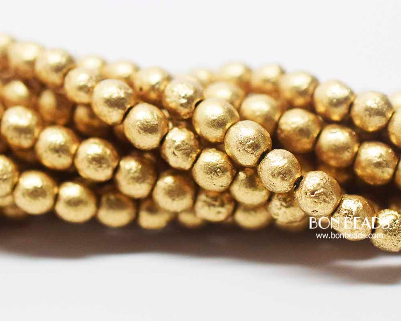 4mm Aztec Gold Etched Smooth Round Druk 600 Pieces Bon Beads