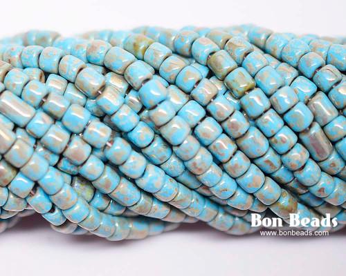 6/0 Aged Blue Turquoise Metallic Picasso Bugles (1/4 Kilo)