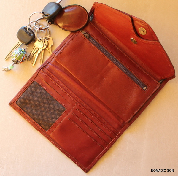 Inside is fully lined, an array of large slip pockets, zipped coin area, drivers license and additional card spaces.