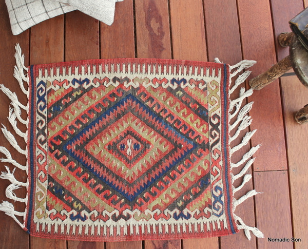 A fine example of classic Fethiye, Western Turkey weaving.  Fine, tight weave with a central protection motif.  Most likely made as an 'ornek' (sample) for producing the larger designed kilims.