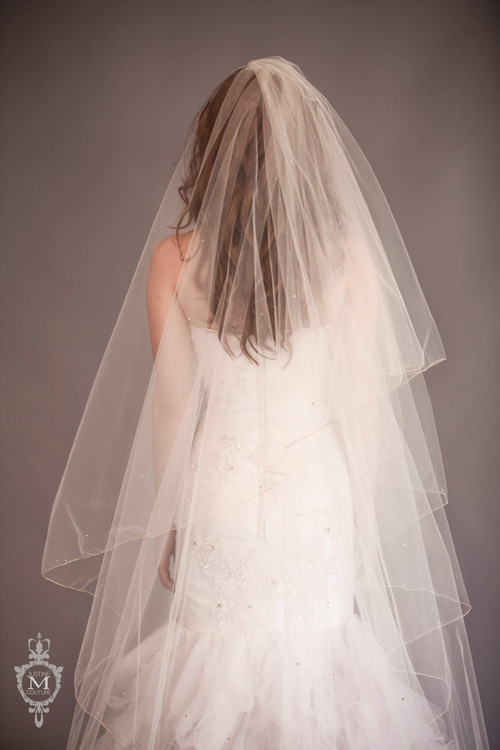 Justine M Couture Leighanne Veil